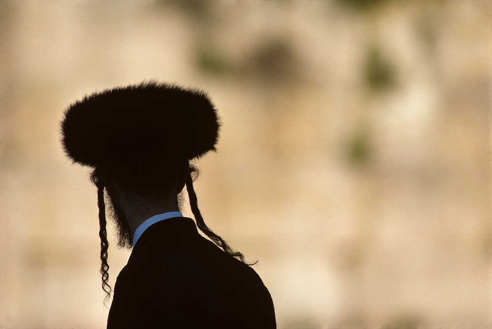 Israel, Jerusalem, Silhouette of Orthodox Jewish man at Western Wall during Passover