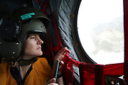 A humanitarian expert from the Department for International Development looks out of the window of an RAF Chinook helicopter as part of a needs assessment mission to Dominica. The Caribbean island of Dominica was devastated by the category 5 Hurricane Maria on Sept 19th, and the Prime Minister of the country, Roosevelt Skerrit requested emergency international assistance. The UK already had military aircraft in the region responding to the damaged caused by Hurricane Irma. A Chinook helicopter from 27 Squadron RAF was tasked to take a needs assessment team to the island, made up of Royal Engineers, humanitarian experts from DFID and the UN, and members of the Caribbean Disasters &amp; Emergencies Management Agency. The team was the first international assistance to arrive on the island.<br /> <br /> Picture: Russell Watkins/DFID