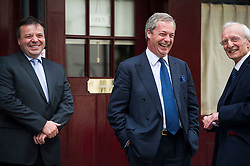 © Licensed to London News Pictures. 15/05/2015.  UKIP leader NIGEL FARAGE leaving Hertford Street Members Club in Mayfair, London with party donors Alan Bown (right)  and Aaron Banks (left) on May 15, 2015. Farage has been critiqued by members of the UKIP party after a u-turn on his decision to stand down as leader. Photo credit: Ben Cawthra/LNP