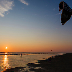 A kite boarder comes ashore at First Encounter Beach in Eastham, Massachusetts.