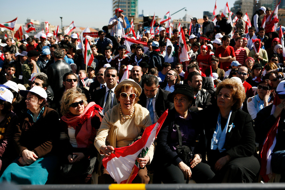 On 14 February 2009 hundreds of thousands of Lebanese marked the fourth anniversary of the assassination of former prime minister Rafiq Hariri at Martyrs' Square in downtown Beirut. Supporters of Hariri's Mostaqbal (Future) movement and their allies in the March 14 coalition carry party flags and pictures of the number of assassinated Lebanese politicians and journalists who have been killed in recent years. The event was highly politicized with parliamentary elections set to take place in June where the March 14 coalition faces a strong opposition movement (March 8) led by the resistance movement and political party in Lebanon, Hizballah. A number of leading political figures spoke at the event, including Hariri's son and now Mostaqbal head, Saad Hariri, who has taken over as a leading political figure in Lebanon since his father's assassination. ///March 14 supporters cheer while listening to their leaders at Martyrs' Square in downtown Beirut.