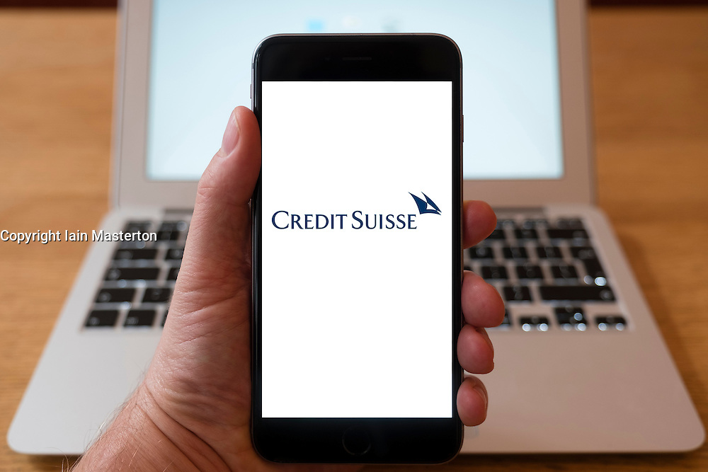 Using iPhone smartphone to display logo of Credit Suisse , the Swiss multinational financial services holding company