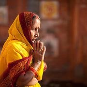 A  Hindu woman prays for morning prayers.