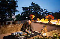 ROME, ITALY - 3 JUNE 2015: A DJ is at work here at the McKim Medal Gala honouring Carlo Petrini and Paolo Sorrentino at the American Academy  in Rome, Italy, on June 3rd 2015.