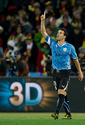 Andres Scotti of Uruguay celebrates after he scored  during penalty shots at the  2010 FIFA World Cup South Africa Quarter Finals football match between Uruguay and Ghana on July 02, 2010 at Soccer City Stadium in Sowetto, suburb of Johannesburg. Uruguay defeated Ghana after penalty shots. (Photo by Vid Ponikvar / Sportida)