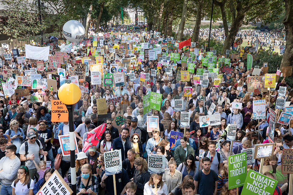 © Licensed to London News Pictures. 20/09/2019. London, UK. Young activists taking part in the Global Climate Strike demonstration listen to speeches near Parliament. Thousands of similar actions are taking place all over the UK and the rest of the world. Photo credit: Peter Macdiarmid/LNP