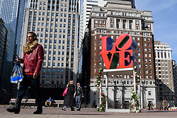 Bouquets of roses decorate the pedestal of the iconic LOVE Park statue, in Philadelphia, PA, on Valentines Day, February 14, 2019.