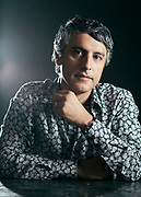 """LOS ANGELES, CA - AUGUST 8, 2013 - Dr. Reza Aslan, author of the book """"Zelot"""" poses at his home on August 8, 2013, in Los Angeles, California. Dr. Aslan's doctorate in the sociology of religions encompasses expertise in the history of religion. Aslan's bachelor's degree is in religious studies, with an emphasis on scripture and traditions. His minor was in biblical Greek. He has a master of theological studies degree from Harvard University, in world religions, and a Ph.D. from the University of California, Santa Barbara, in the sociology of religions. Reza also has a master of fine arts degree from the University of Iowa. Dr. Aslan is currently associate professor of creative writing at the University of California, Riverside, and a cooperative faculty member in the department of religion, and he teaches in both disciplines. He was previously Wallerstein Distinguished Visiting Professor of religion at Drew University, where he taught from 2012 to 2013, and assistant visiting professor of religion at the University of Iowa, where he taught from 2000 to 2003. He has written three books on religion. (Photo by Bret Hartman/For The Washington Post)"""