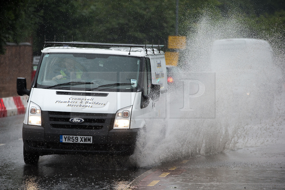 © Licensed to London News Pictures . 11/06/2016 . Manchester , UK . A van is driven through thick standing water on Bury Old Road in North Manchester following heavy rain . Photo credit : Joel Goodman/LNP