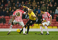 Photo: Leigh Quinnell.<br /> Watford v Stoke City. Coca Cola Championship.<br /> 14/01/2006. Watfords Marlon King crosses the ball past Stokes  Junior and Karl Henry.