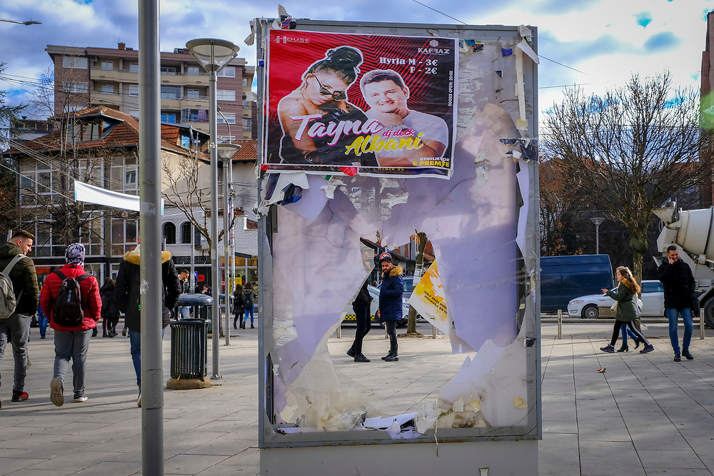 A man looks through a disused advertising board in the shopping area in the south side of Mitrovica, a town in Northern Kosovo that straddles the river Ibar that separates the Serbian and Albanian districts of Mitrovica, Kosovo on the 12th of December 2018.  Mitrovica or Kosovska Mitrovica is a city and municipality located in Northern Kosovo.  (photo by Andrew Aitchison / In pictures via Getty Images)