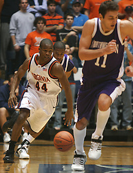 UVA point guard Sean Singletary (44) dribbles the ball up court against Northwestern.  Singletary lead the Hoos with 23 points as UVA beat the Wildcats 72-57 in the ACC/BigTen Challenge...The Virginia Cavaliers Men's Basketball team defeated the Northwestern Wildcats 72-57 in the ACC/BigTen Challenge at University Hall in Charlottesville, VA on November 30, 2005..