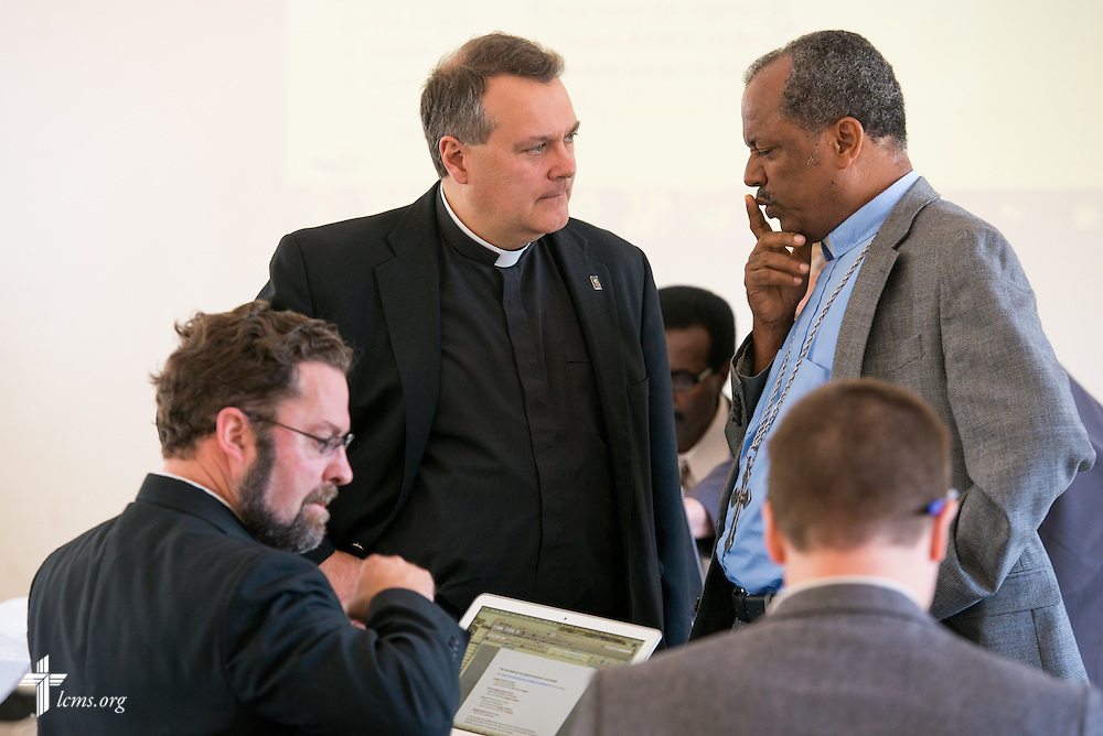 The Rev. Dr. Lawrence R. Rast, Jr., chairman of the Commission on Theology and Church Relations (CTCR) and president of Concordia Theological Seminary in Fort Wayne, Ind., talks to the Rev. Dr. Wakseyoum Idosa, president of the Ethiopian Evangelical Church Mekane Yesus, during a break in discussions at Mekane Yesus Seminary in Addis Ababa, Ethiopia, on Tuesday, Nov. 11, 2014. LCMS Communications/Erik M. Lunsford