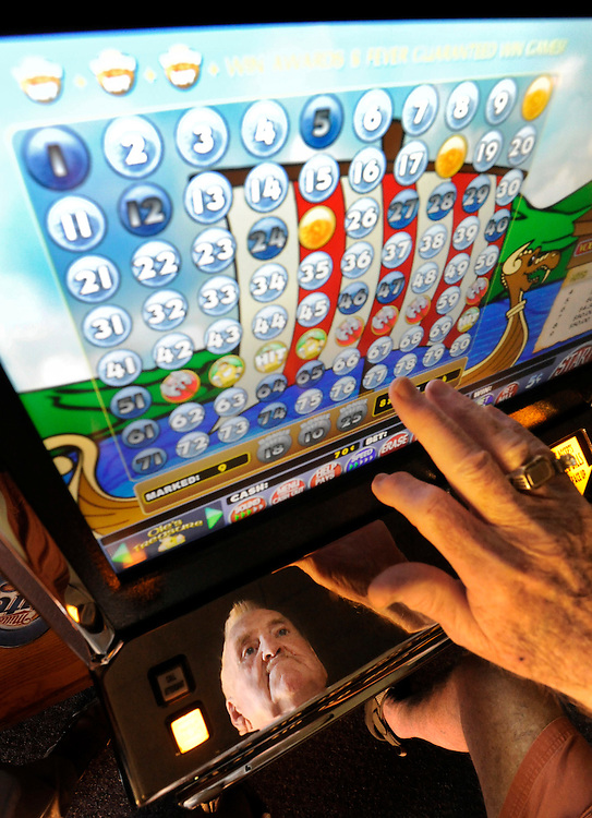 "Donnie Schoepf plays a video lottery game, ""Ole's Treasure,"" at Lucky Kruser's Casino in the Western Mall. If small casinos are to rebound from the double hit of the sour economy and smoking ban, new games might lead the way back."