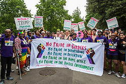 London, UK. 6 July, 2019. Activists from Lesbians and Gays Support The Migrants, African Rainbow Family, the Outside Project, Micro Rainbow and many other LGBT+ groups prepare to take part in a London Pride Solidarity March at the very rear of Pride in London - stewards tried to prevent them from joining - in solidarity with those for whom Pride in London is inaccessible and in protest against the corporatisation of Pride in London.