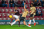 Andy Considine (#4) of Aberdeen FC attempts to stop Uche Ikpeazu (#19) of Heart of Midlothian FC crossing the ball during the Betfred Scottish Football League Cup quarter final match between Heart of Midlothian FC and Aberdeen FC at Tynecastle Stadium, Edinburgh, Scotland on 25 September 2019.