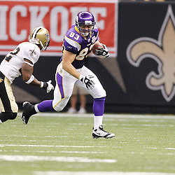 September 9, 2010; New Orleans, LA, USA; Minnesota Vikings tight end Jeff Dugan (83) runs away from New Orleans Saints cornerback Tracy Porter (22) during first half of the NFL Kickoff season opener at the Louisiana Superdome. Mandatory Credit: Derick E. Hingle