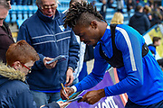 Gillingham FC defender Gabriel Zakuani (6) signs an autograph for a young fan before the EFL Sky Bet League 1 match between Gillingham and Rochdale at the MEMS Priestfield Stadium, Gillingham, England on 13 January 2018. Photo by Martin Cole.