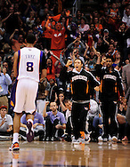 Mar. 23, 2011; Phoenix, AZ, USA; Phoenix Suns guard Steve Nash (15) reacts on the bench after teammate forward Channing Frye (8) puts up a basket against the Toronto Raptors at the US Airways Center. The Suns defeated the Raptors 114-106. Mandatory Credit: Jennifer Stewart-US PRESSWIRE..