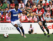 Alan Judge battling for ball with Ainsley Maitland-Niles during the Sky Bet Championship match between Brentford and Ipswich Town at Griffin Park, London, England on 8 August 2015. Photo by Matthew Redman.