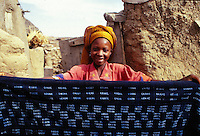 Mali,Dogon country- woman artist with a cloth