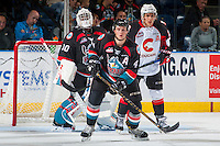 KELOWNA, CANADA - SEPTEMBER 28: Gordie Ballhorn #4 stands in front of the net of Michael Herringer #30 of Kelowna Rockets against the Prince George Cougars on September 28, 2016 at Prospera Place in Kelowna, British Columbia, Canada.  (Photo by Marissa Baecker/Shoot the Breeze)  *** Local Caption *** Michael Herringer; Gordie Ballhorn;