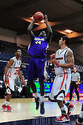 November 28, 2011; Moraga, CA, USA; San Francisco State Gators forward James Albright (44) shoots the ball over Jacksonville State Gamecocks forward Rinaldo Mafra (right) during the first half of the Shamrock Office Solutions Classic consolation game at McKeon Pavilion. The Gators defeated the Gamecocks 71-68.