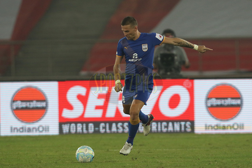 Lucian Goian of Mumbai City FC kicks the ball during match 17 of the Indian Super League (ISL) season 3 between Delhi Dynamos FC and Mumbai City FC held at the Jawaharlal Nehru Stadium in Delhi, India on the 18th October 2016.<br /> <br /> Photo by Rahul Goyal / ISL/ SPORTZPICS