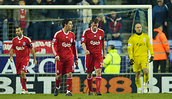 WIGAN, ENGLAND - Monday, March 8, 2010: Liverpool's Jamie Carragher looks dejected as Wigan Athletic score the opening goal during the Premiership match at the DW Stadium. (Photo by David Rawcliffe/Propaganda)