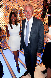 COUNT & COUNTESS LEOPOLD VON BISMARCK at a party to celebrate the opening of the Louis Vuitton Bond Street Maison, New Bond Street, London on 25th May 2010.