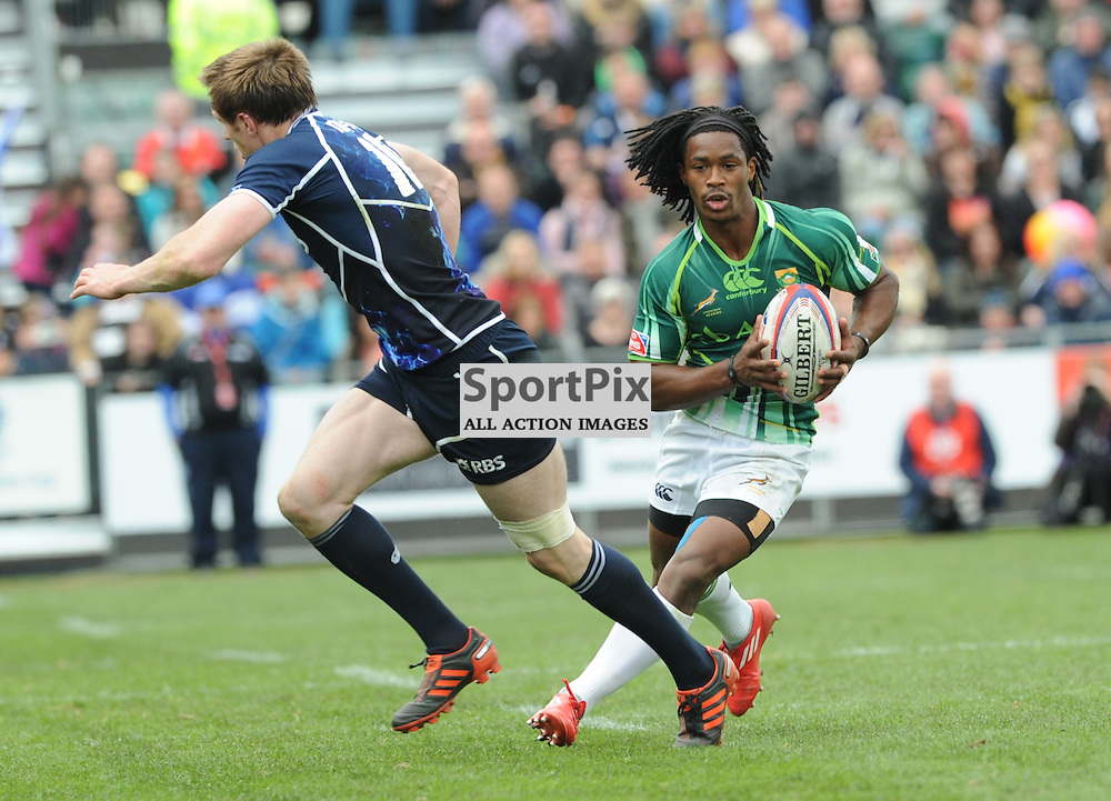 South Africa's Branco Du Preez wrong foots Scotlands James Fleming at the Emirates Airlines Glasgow 7s at Scotstoun Stadium 5th / 6th May 2012 .Lorraine Hill : STOCKPIX