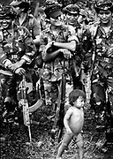 The infant son of a Nicaragua Contra commander parades infront of the troops at a rebel basecamp on the Honduras Nicaragua border. 1987