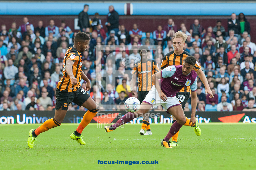 Fraizer Campbell of Hull City and Neil Taylor of Aston Villa challenge for the ball during the Sky Bet Championship match at Villa Park, Birmingham<br /> Picture by Matt Wilkinson/Focus Images Ltd 07814 960751<br /> 05/08/2017