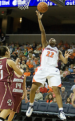 UVA's Monica Wright (22) gets a shot off against BC.  Wright had 13 points in the game including the game winning three pointer as the Cavaliers defeated the Eagles 65-63 in overtime at the John Paul Jones Arena in Charlottesville, VA on January 14, 2007.