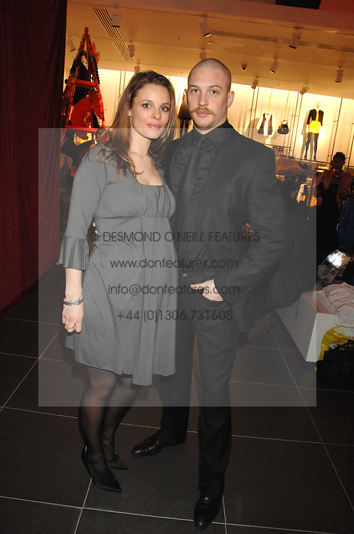 Actor TOM HARDY and RACHEL SPEED at a party to celebrate the opening of the new H&amp;M store at 234 Regent Street, London on 13th February 2008.<br />