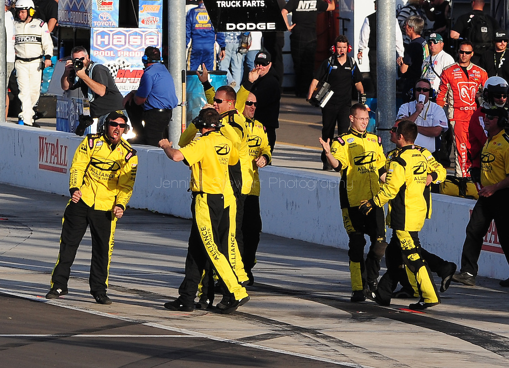 Nov. 12 2011; Avondale, AZ, USA; The crew of NASCAR Nationwide Series driver Sam Hornish Jr. celebrates after he won the Wypall 200 at Phoenix International Raceway. Mandatory Credit: Jennifer Stewart-US PRESSWIRE