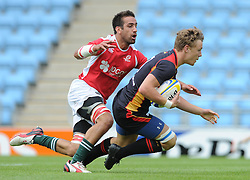 Tim Lightenberg of Germany is challenged by Diogo Miranda of Portugal - Photo mandatory by-line: Dougie Allward/JMP - Mobile: 07966 386802 - 11/07/2015 - SPORT - Rugby - Exeter - Sandy Park - European Grand Prix 7s