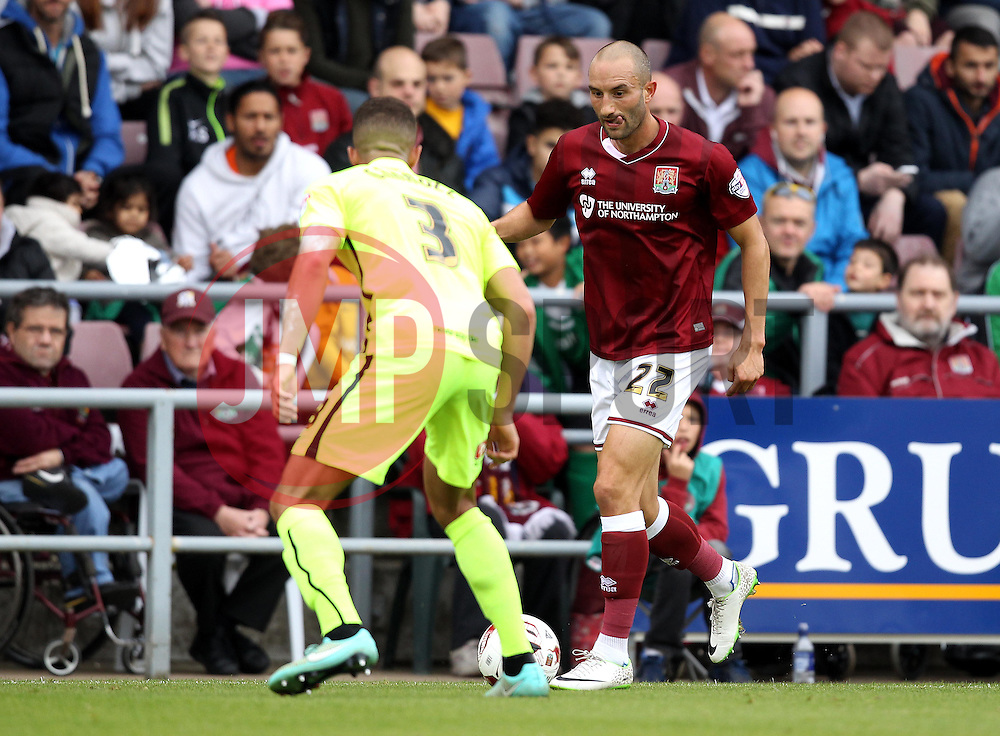 Chris Hackett of Northampton Town takes on Jake Carroll of Hartlepool United - Mandatory byline: Robbie Stephenson/JMP - 07966 386802 - 10/10/2015 - FOOTBALL - Sixfields Stadium - Northampton, England - Northampton Town v Hartlepool - Sky Bet League Two