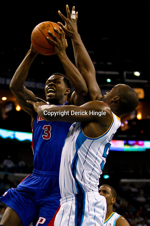 December 8, 2010; New Orleans, LA, USA; Detroit Pistons point guard Rodney Stuckey (3) shoots over New Orleans Hornets center Emeka Okafor (50) during the first half at the New Orleans Arena. Mandatory Credit: Derick E. Hingle