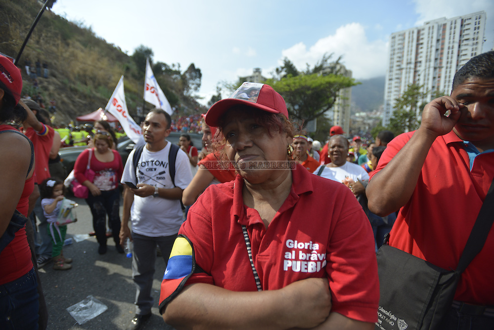 CARACAS - MARCH 15, 2012: Thousands of people followed the funeral procession on the streets of the city carrying the remains of Venezuelan President Hugo Chavez who died past March 5 after fight against cancer lasted two years. (Photo by Gregorio Marrero)