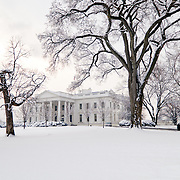 The White House in Washington DC after a recent heavy snowfall that blanketed the grounds and trees.