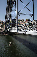 Young boys jumping from the bridge D.Luis in Porto.