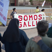 Anna Rondon, top right, from New Mexico Social Justice Equity Institute speaks at the immigrant rally held at the courthouse square in downtown Gallup Monday.