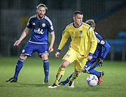 Oliver Norburn (Guiseley) turns with the ball looking to get a pass away during the Conference Premier League match between FC Halifax Town and Guiseley at the Shay, Halifax, United Kingdom on 5 December 2015. Photo by Mark P Doherty.