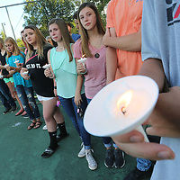 Hettleton High School students and hundreds of other residents gathered Monday night at the schools tennis courts to hold a candlelight vigil for Maggie Riley and Brandon Coward.