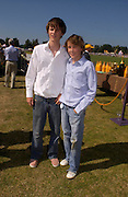 Tara Ferry and Merlin Ferry. Veuve Clicquot Gold Cup Final at Cowdray Park. Midhurst. 17 July 2005. ONE TIME USE ONLY - DO NOT ARCHIVE  © Copyright Photograph by Dafydd Jones 66 Stockwell Park Rd. London SW9 0DA Tel 020 7733 0108 www.dafjones.com
