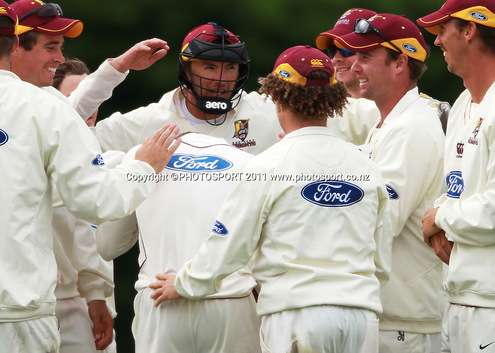 Northern players congratulate Kane Williamson after the wicket of James Franklin with wicket keeper Peter McGlashan on day 3 of the 4 Day Plunket Shield cricket match between the Northern Knights and Wellington Firebirds. Played on Lincoln 2 in Lincoln, Canterbury. Wednesday 16 November 2011. Joseph Johnson/photosport.co.nz