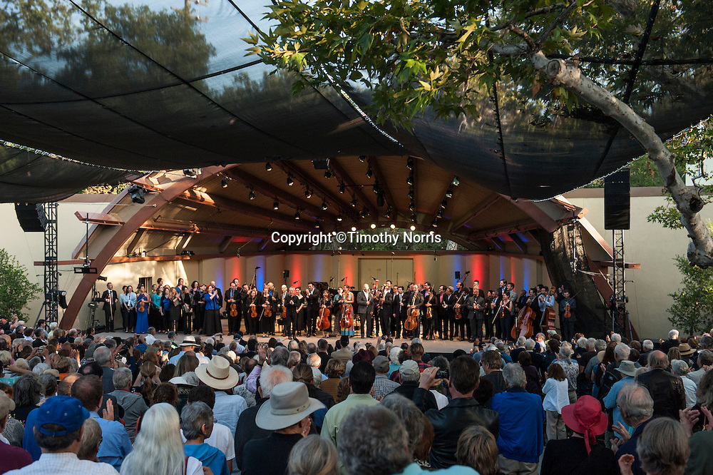 Jeremy Denk (piano), The Knights conducted by Eric Jacobsen and soloists Cheryl Cain (soprano), Christa Pfeiffer (soprano), Heidi Waterman (alto), John Davey Hatcher (bass), Chung-Wai Soon (baritone) and Jeff Fields (bass) take a bow at the close of the 68th Ojai Music Festival at Libbey Bowl on June 15, 2014 in Ojai, California.