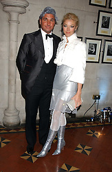 MISS TAMARA BECKWITH and MR GEORGE VERONI at Andy & Patti Wong's annual Chinese New Year party, this year celebrating the year of the dog held at The Royal Courts of Justice, The Strand, London WC2 on 28th January 2006.<br />