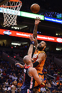 Apr 1, 2016; Phoenix, AZ, USA; Phoenix Suns center Tyson Chandler (4) shoots the ball over Washington Wizards center Marcin Gortat (13) in the second half at Talking Stick Resort Arena. The Washington Wizards won 106- 99. Mandatory Credit: Jennifer Stewart-USA TODAY Sports